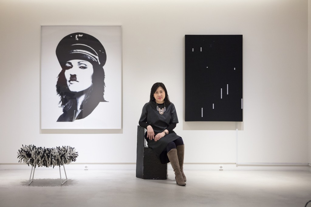 Christina Heekyung Kang in front of pieces from her collection. Photo: Jinkyun Ahn. Courtesy of Christina H. Kang.