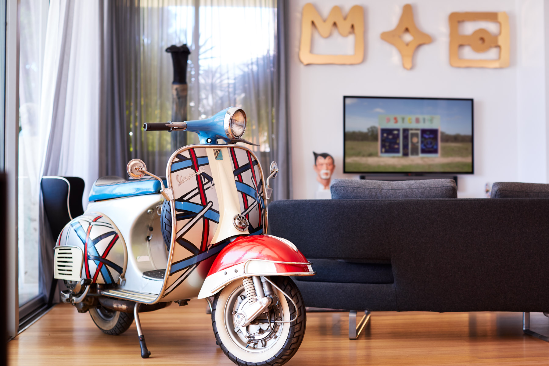 "Jasper Knight, painted Vespa scooter; Reko Rennie, ""Black Diamond"" (Gold); Kate Mitchell, ""Future Fallout"" video art; Phil James, ""Mighty Atamo"" ceramic bust. Courtesy of Teresa and Andre Biet."