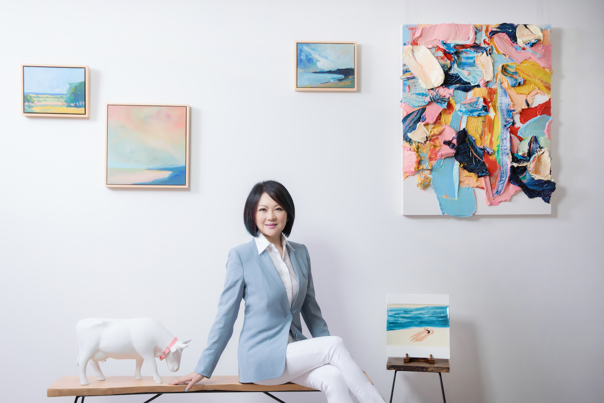 Maggie Tsai sitting next to the painting by Zhu Jinshi (upper right). Courtesy of Fubon Art Foundation.