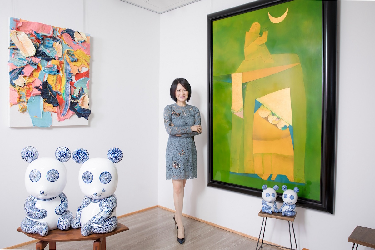 Maggie Tsai in her office with Nguyen Thanh Chuong's work on the right. Courtesy of Fubon Art Foundation.