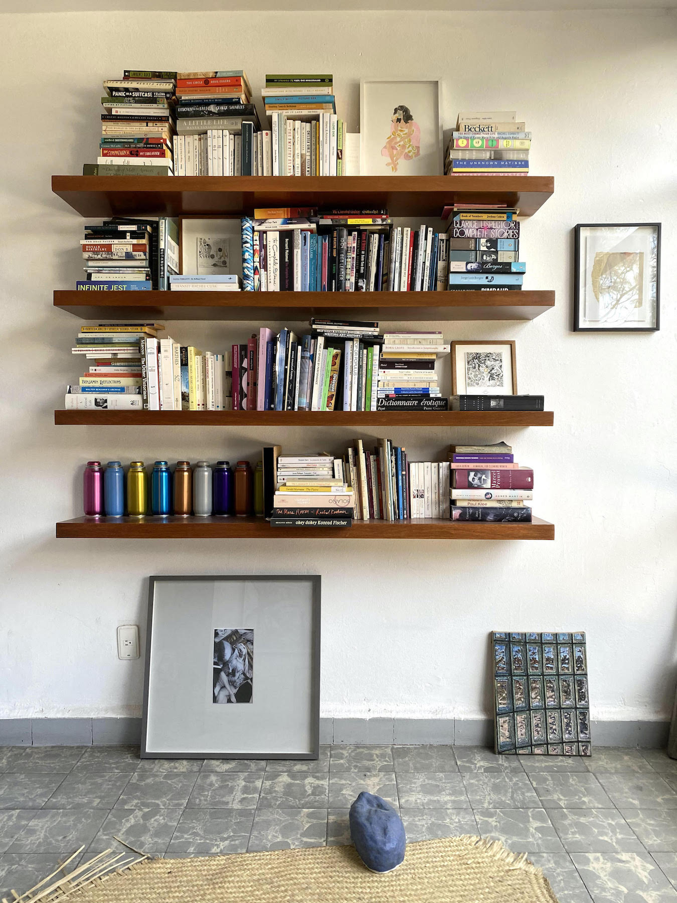 Shelves of books and works by Priscilla Weidlein, Jose Antonio Suarez Londoño, Padraig Timoney, Jean-Luc Moulène, Becky Beasley, Martin Soto Climent, Jennifer J. Lee, and Kate Newby. Courtesy of Chris Sharp.