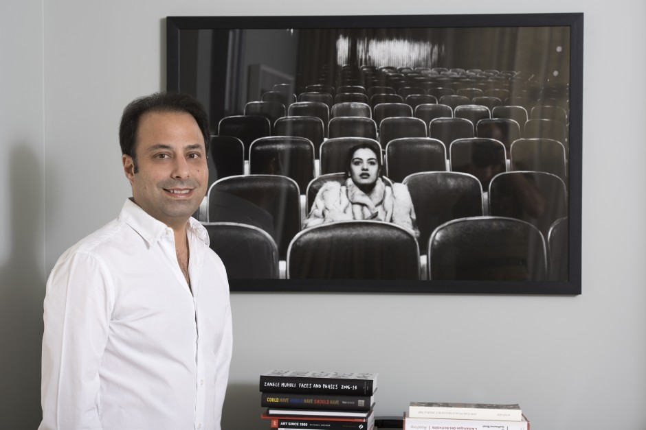 Tarek in front of a piece from his photography collection  – Fouad Elkhoury: Sherihan, Egyptian Cinema, 1985 – 1990, Cairo, 1987. Courtesy of Tarek Nahas.
