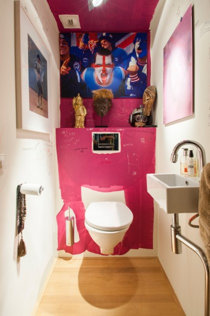 "Toilet with ""Robbie Williams"" by Paul Smith, artwork by Nathan Azhderian, tribal art and artist's graffiti.  Courtesy of Antoine de Werd."