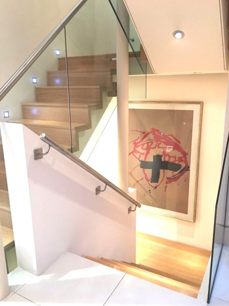 An artwork by Antoni Tapies is lighting up the staircase. Courtesy of Antonio Mugica.