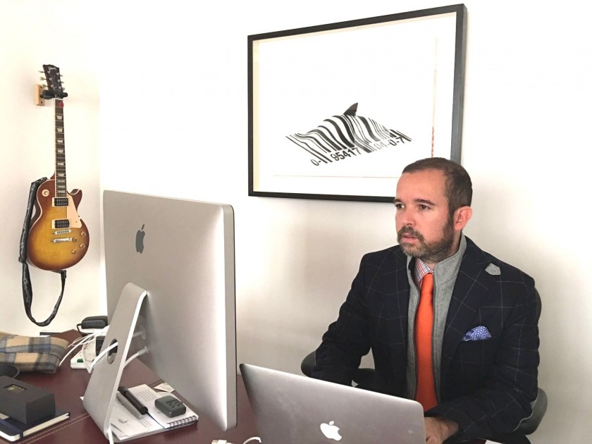 "The CEO with ""Barcode Shark"" by Banksy at the back. Courtesy of Antonio Mugica."