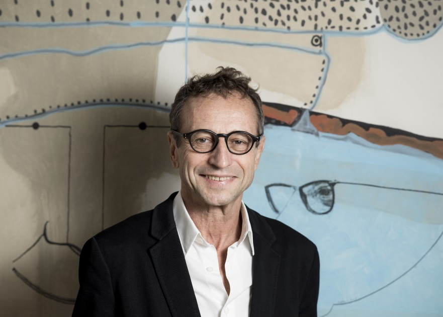 François Blanc in front of an artwork by Jean-Michel Alberola. Photo: Eric Garault. Courtesy of Galerie Templon.