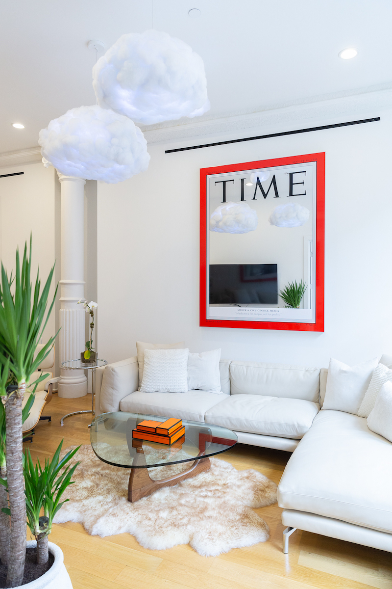 The centerpiece in the living room is commissioned work by Mungo Thomson, August 18, 1952 (George W. Merck), 2019. That piece is particularly special to George because it is modeled after his great-grandfather's actual TIME cover from August 18, 1952 (image below). Photo: Masha Maltsava. Courtesy of George Merck.
