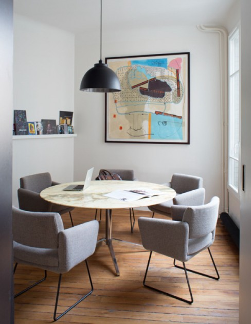 A piece by Jean-Michel Alberola is above the chairs by designer Joseph-André Motte and the table designed by Eero Saarinen, at the office of Communic'Art. Photo: Jean-François Jaussaud. Courtesy of François Blanc.