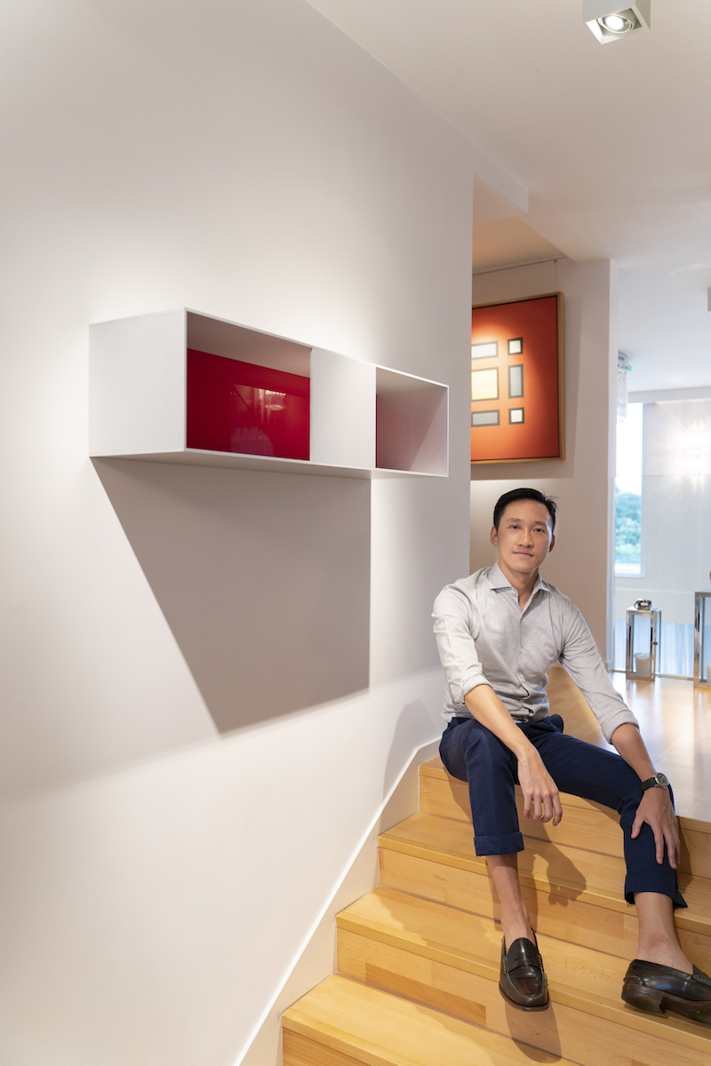 Evan Chow with some of his collection, from left: Donald Judd, Huang Rui. Photo: TR_ConceptnVisual. Courtesy of Evan Chow.