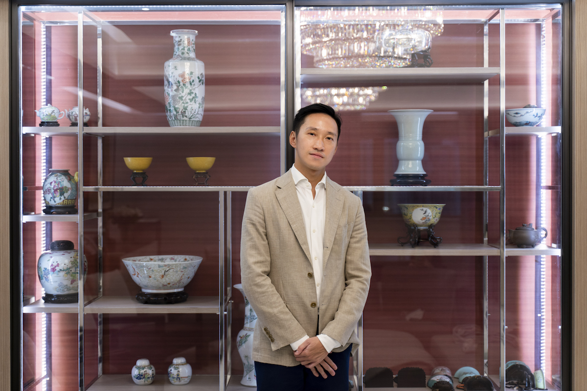 Evan Chow in front of a fine collection of Chinese antiques. Photo: TR_ConceptnVisual. Courtesy of Evan Chow