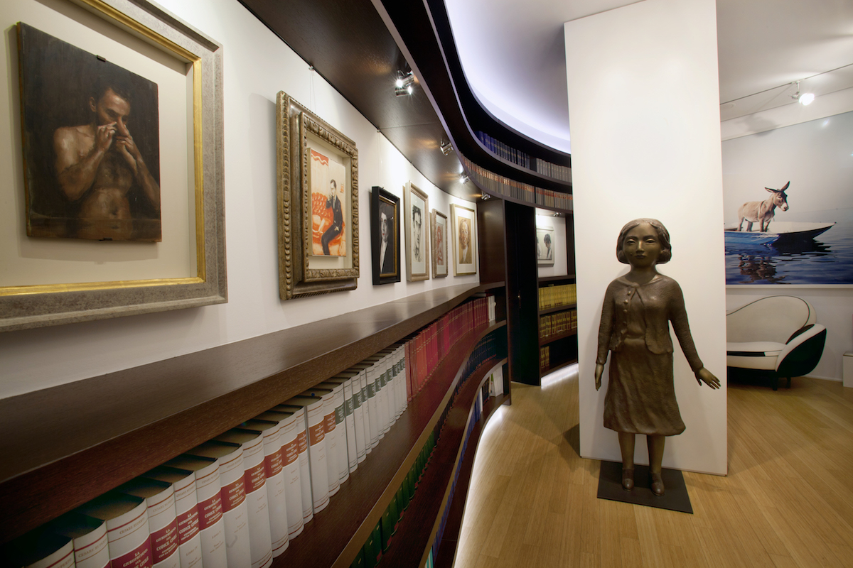 Inside Giuseppe Iannaccone's law firm: (sculpture) Kiki Smith, Guardian, 2005; and on the wall—Michaël Borremans, The Measure II, 2007; Elizabeth Peyton, Fred Huges in Paris, 1994; and Paola Pivi, Senza titolo, 2003 (on the right). Courtesy of Giuseppe Iannaccone.