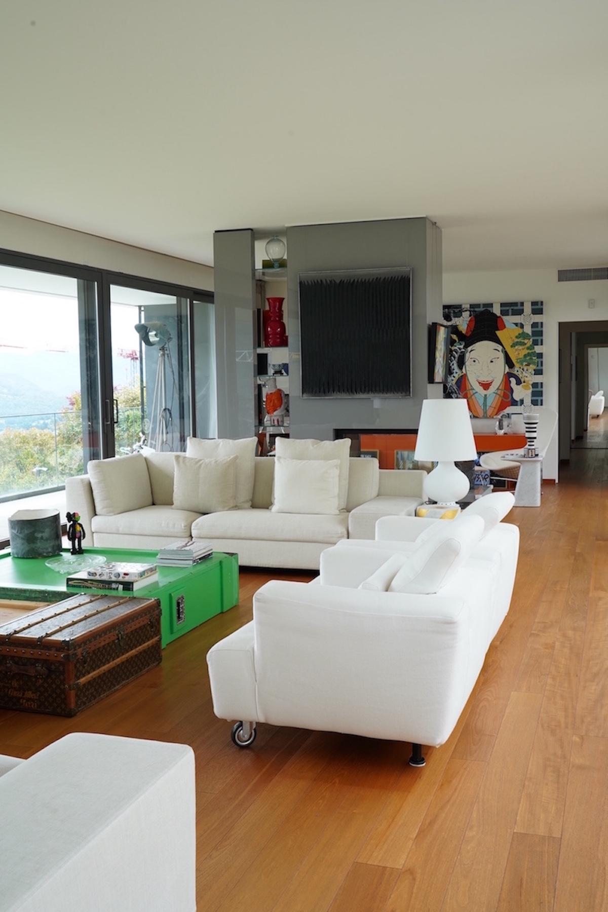 An art-filled living room: Paolo Icaro, Kaws, Sandro Chia (head sculpture in the library), Heinz Mack, Roberto Coda Zabetta, Jonas Mekas (just partially), Ettore Sottsass. Courtesy of Bruno Bolfo.