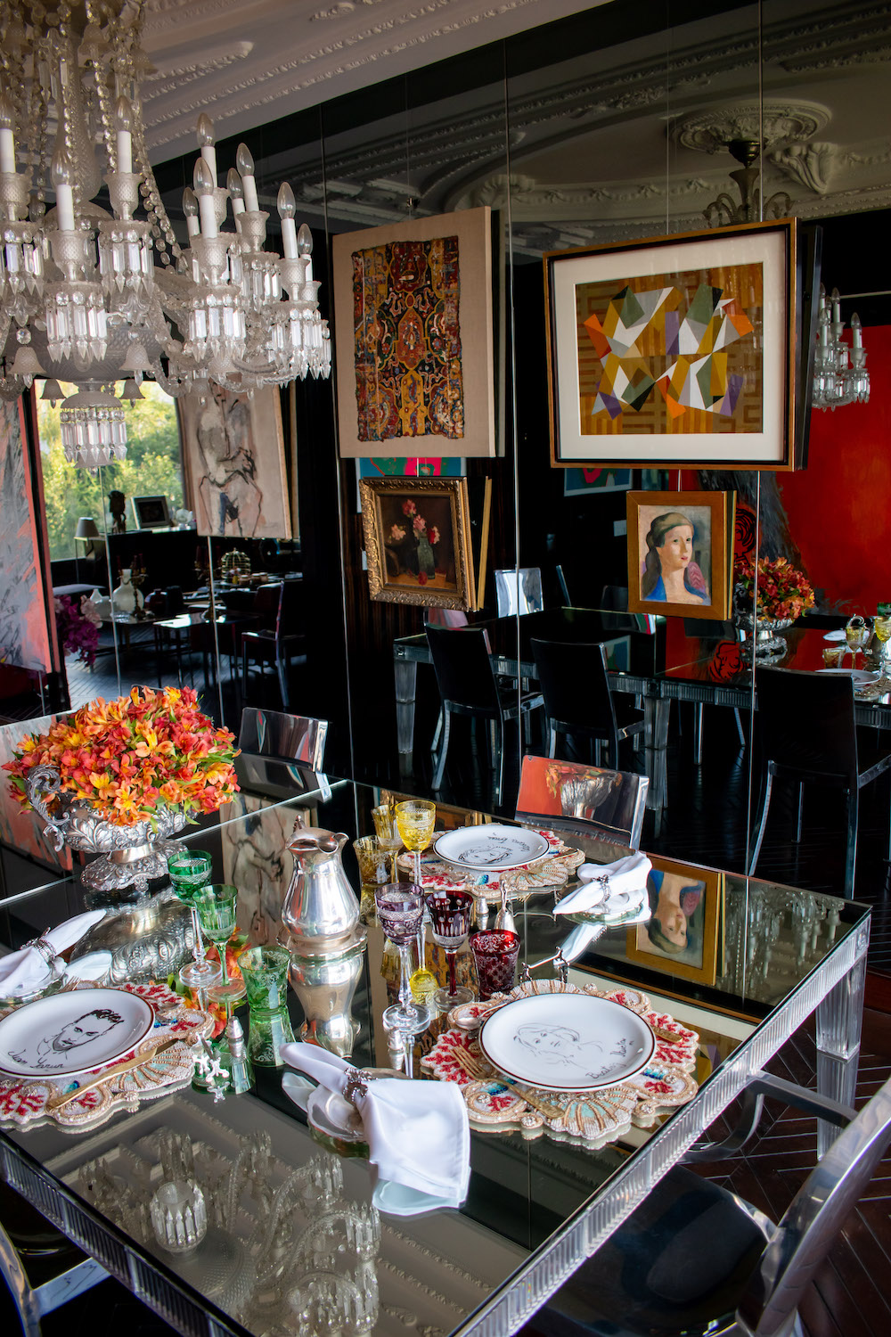 """Grace Weinrib, """"Pencil (triptych)"""" (partially); Enrique Castro Cid, """"Untitled""""; Josefina Guilisasti, """"Fragmento Persa S. XVII""""; Matilde Pérez, """"Flores"""" and """"Untitled""""; Graciela Aranis, """"Untitled""""; Philippe Starck Emeco Hudson Chairs; Baccarat dinning table by Philippe Stark; and Baccarat chandelier Philippe Starck. Photo: Andrés Herrera. Courtesy of Juan Yarur."""