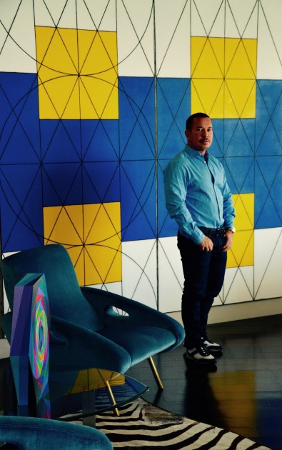 """Collector Fernando Lopez with a work by Matt Mullican, """"The Shift""""."""