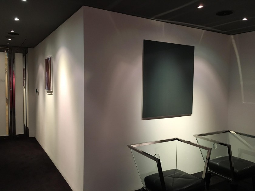 "Wolfgang Tillmanns, ""Lighter VI"", 2007 (left) and Gerhard Richter, ""Mirror, Grey (739-2)"", 1991 (right), in Kazunari Shirai's office in Hong Kong. Courtesy of Kazunari Shirai."
