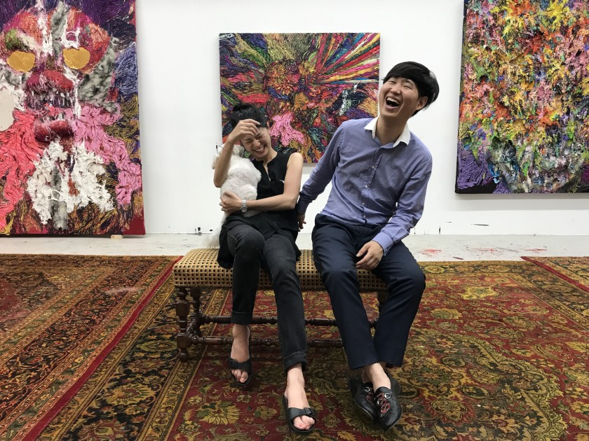 Hong Gyu Shin and art professional Masako Shiba. Background: paintings by Hyon Gyon. Courtesy of Hong Gyu Shin.