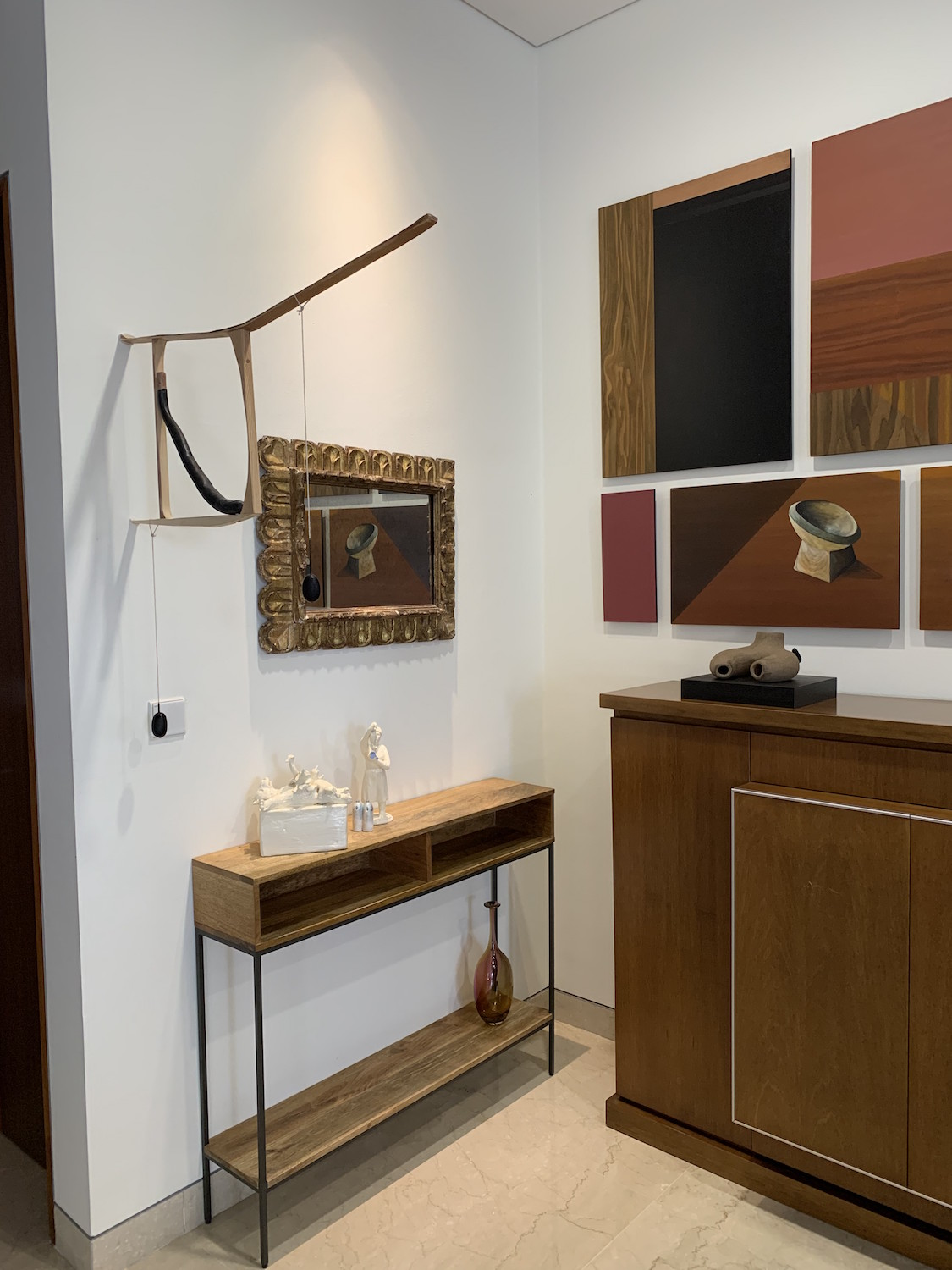 Part of the collection with artworks on the left wall by Diego Bianchi and Jordan Maclachlan. On the right wall featuring a large painting by Hulda Guzman and sculpture on the cabinet by Gala Porras-Kim. Courtesy of Benedicta M. Badia de Nordenstahl.