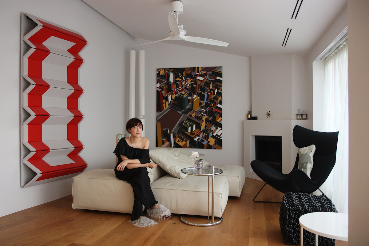 Hee Jae Kang in her art-filled home, with a Robert Moreland (left) and a Miguel Angel lglesias (right). Courtesy of Hee Jae Kang.