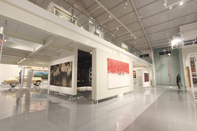 """Left to right: Soenaryo, Senja Kala, 2018; Rudi Mantofani, """"Merah dan Putih"""", 2017; Handiwirman Saputera, Tak Berakar Tak Berpucuk, 2011; Antony Gormley, Gird, 2014. Courtesy of Tumurun Private Museum."""