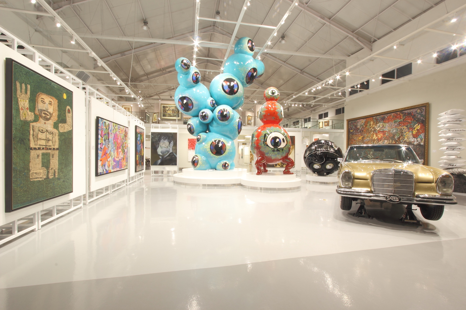 Wedhar Riyadi, Changing Perspective, 2017 in the middle. Surrounded by works by (left to right) Yunizar, Eddie Hara, Eko Nugroho, Wedhar Riyadi, Ichwan Noor, I Made Djirna, and Tisna Sanjaya, as well as a 1972 Mercedes Benz.