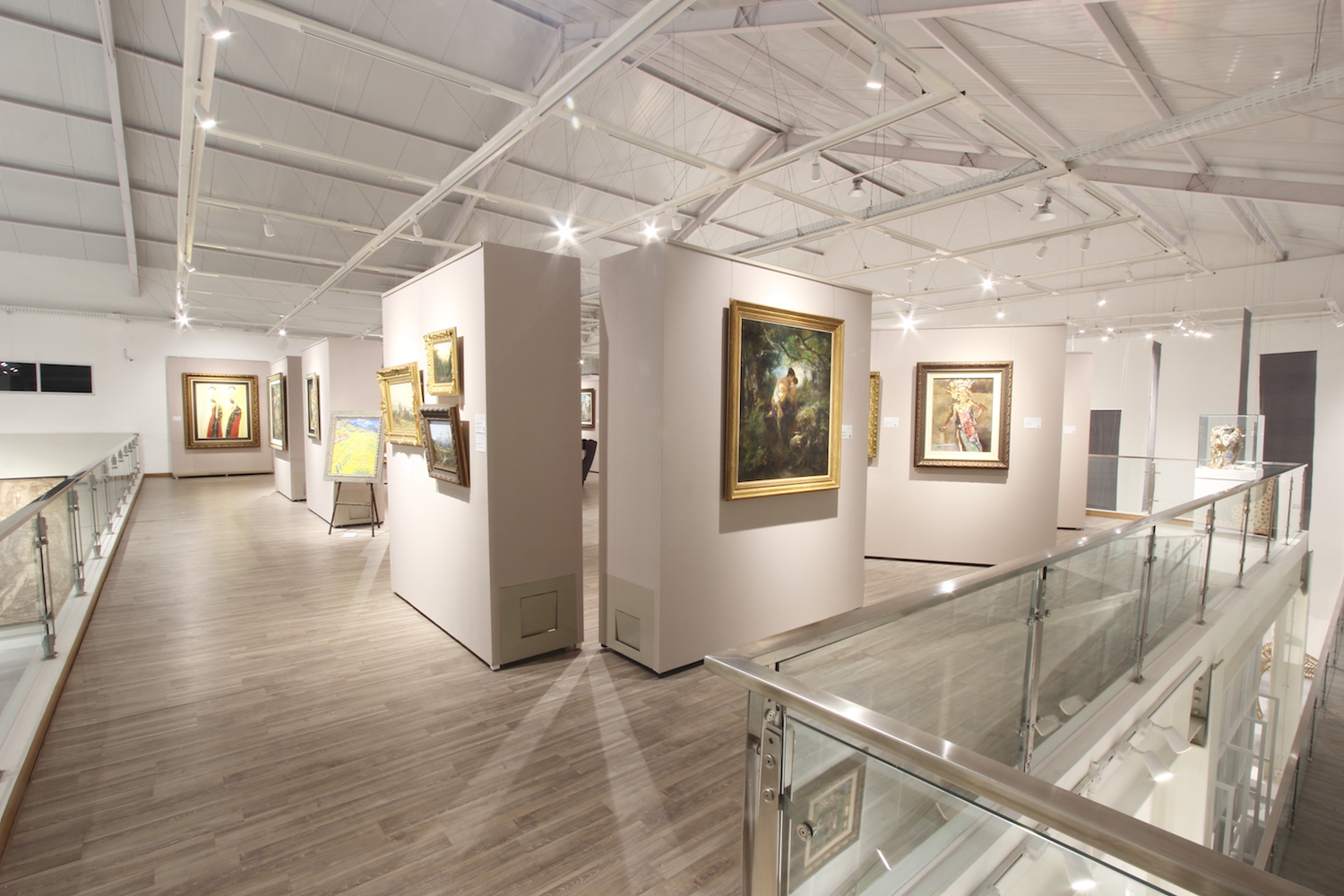 Works from left to right by Srihadi Soedarsono, Theo Meier, Wilhelm Ch. Constant Bleckmann, Maurits Van Den Kerkhoff, Jacob Dirk Van Herwerden, Mari Ten Kate, and Roland Strasser. Courtesy of Tumurun Private Museum.
