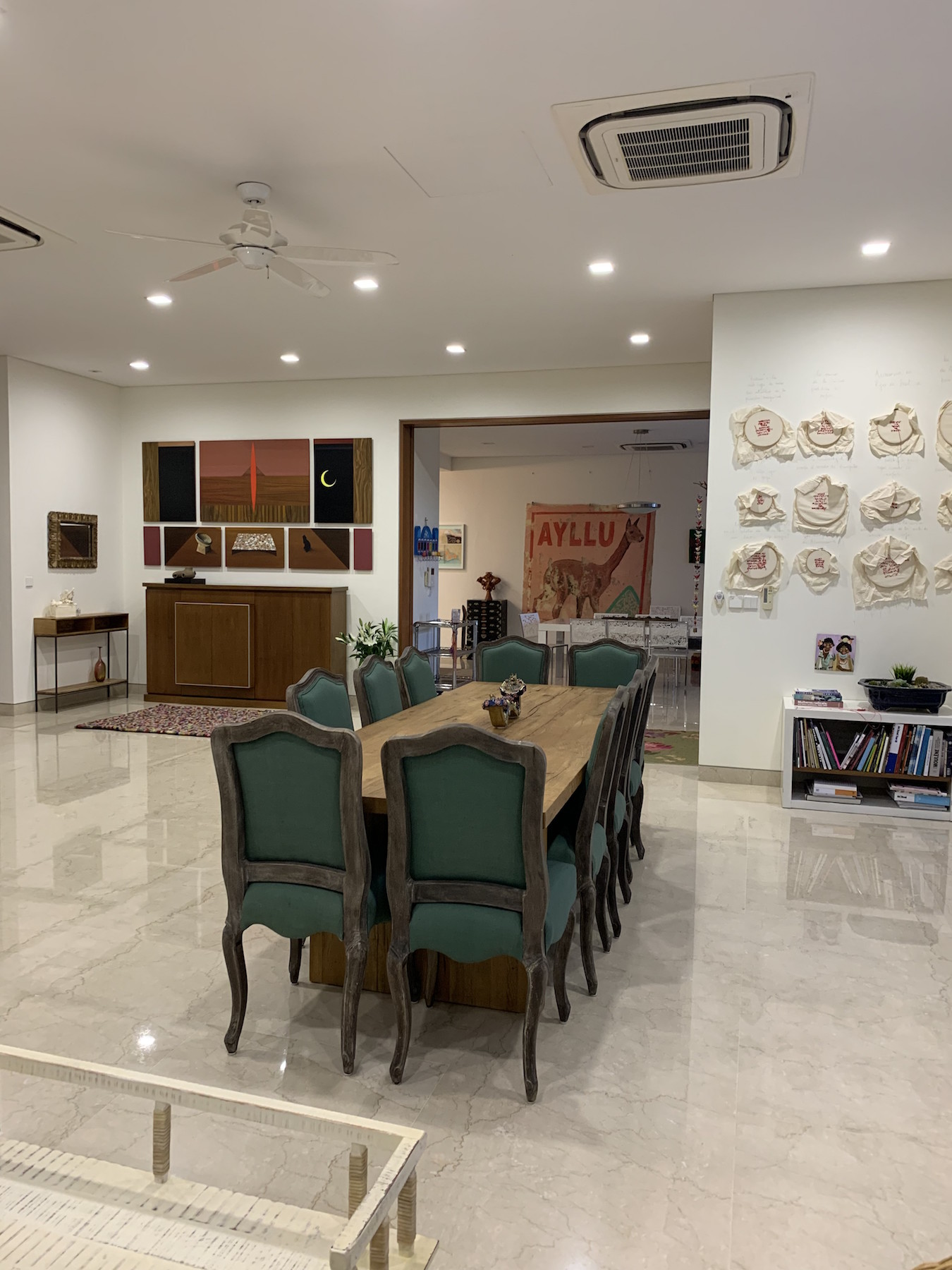The living room of the Nordenstahl family home in Singapore. On the left, artworks by Jordan Maclachlan, Hulda Hhuzman and Gala Porras-Kim. In the middle, a large painting by Jose Carlos Martinat. On the right wall, an installation work by Tania Candiani. Courtesy of Benedicta M. Badia de Nordenstahl.