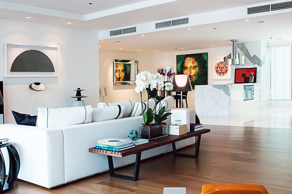Home interior with artworks by Ayesha Sultan, Damien Hirst, Jaber Al Azmeh, Nelson Wilbert and Patrick Hughes. Photo: Jacqueline Sofia. Courtesy of Shohidul Ahad-Choudhury.