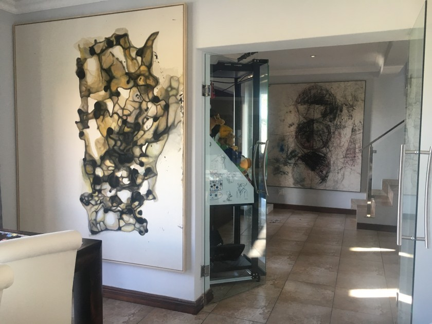 Home interior with artworks by Sergej Jensen, Oscar Murillo and Simon Denny. Courtesy of Louis Kotze.