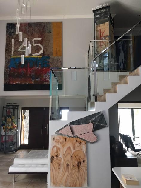 Inside Louis' home, Seth Price - Envelope, Oscar Murillo - 145, Simon Denny - Packaged Goods, Simon Denny - Hack The Commons. Courtesy of Louis Kotze.