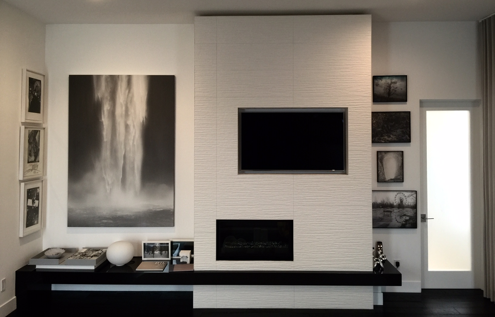 Painting by Christina Craemer, on the left wall are prints by Lebbeus Woods (left) and Todd Hido (right). Courtesy of Melissa de la Cruz and Michael Johnston.
