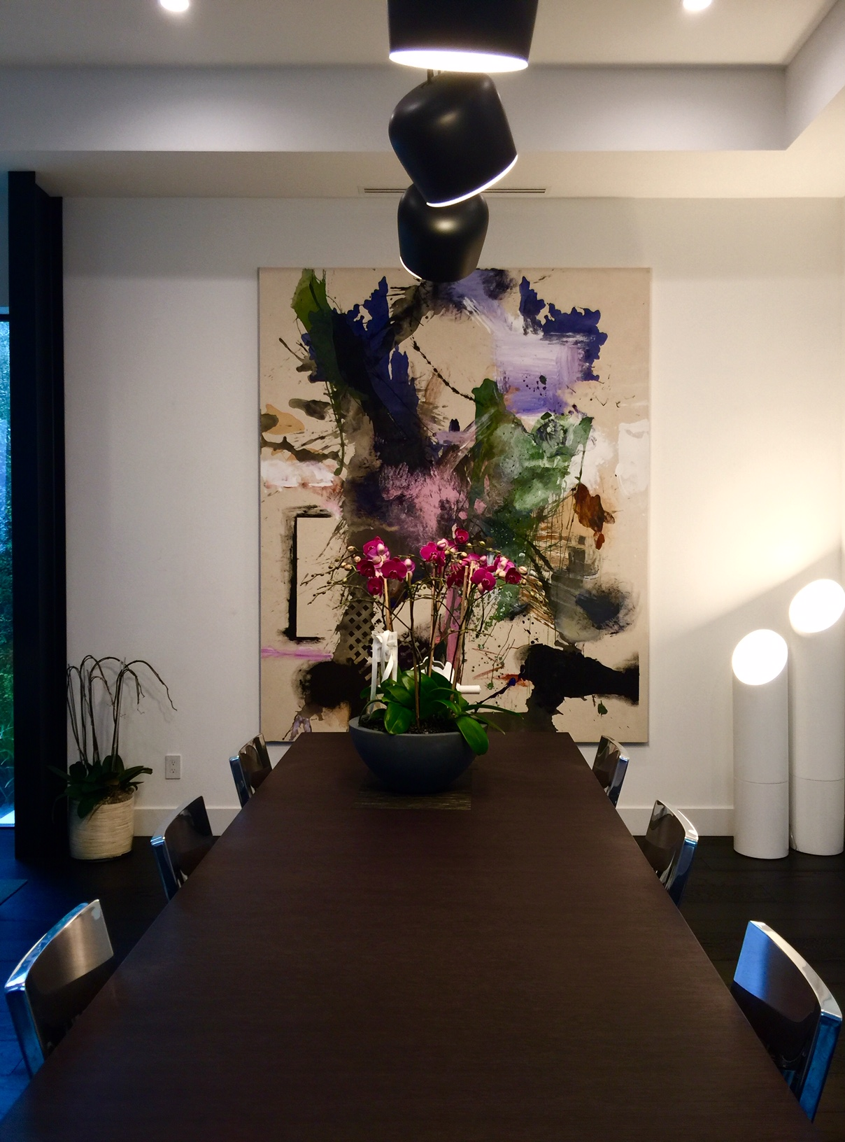 A painting by Elizabeth Neel overlooking the dining table. Courtesy of Melissa de la Cruz and Michael Johnston.