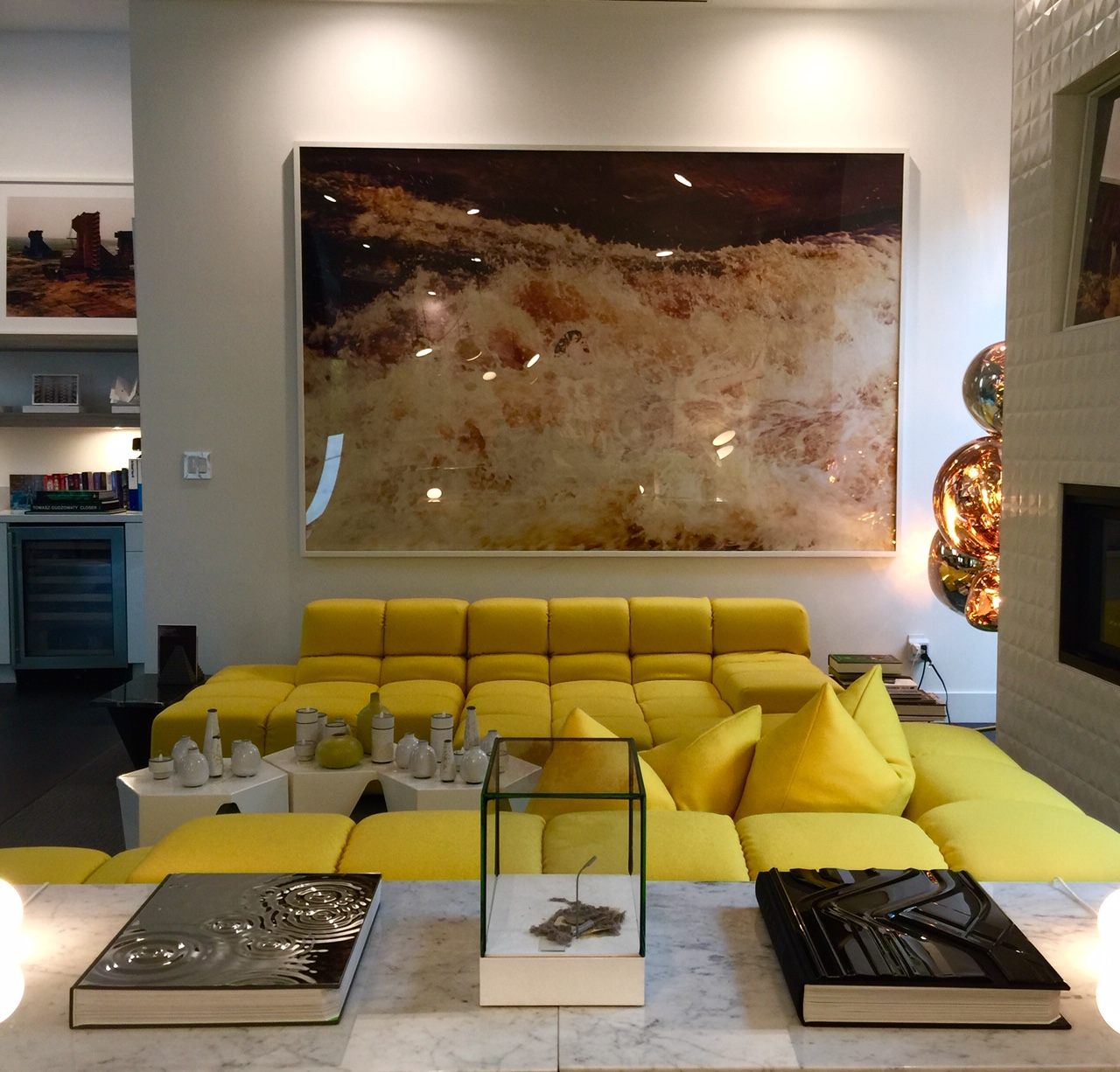 Taschen artist editions for Zaha Hadid and Olafur Eliasson, on the two sides of the center sculpture by Johannesburg Albers. Photo on the left (partial) by Edward Burtynsky. A work by Ryan McGinley above the sofa. Courtesy of Melissa de la Cruz and Michael Johnston.