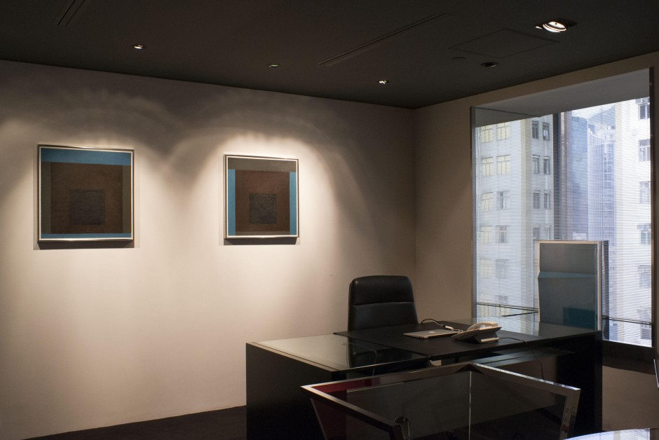 """Josef Albers, """"Homage to the Square [Memorial A and Memorial B]"""", 1962 (pair on the wall) and Wolfgang Tillmans, Lighter IX, 2007 (by the window). Courtesy of Kazunari Shirai."""
