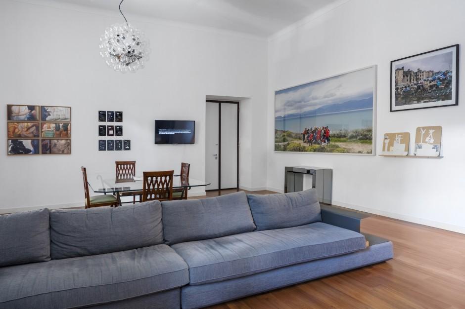 Francesco Taurisano's apartment. In the living room, works by Nuria Guell, Marinella Senatore, Simon Roberts, Marko Tadic (from left to right). Courtesy of CollezioneTaurisano. Photo: Maurizio Esposito.