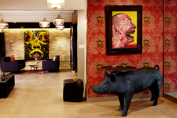 MEET Reception & Lounge with works by Yue Minjun,  Judith Supine, and Marcel Wanders. Courtesy of Meet.