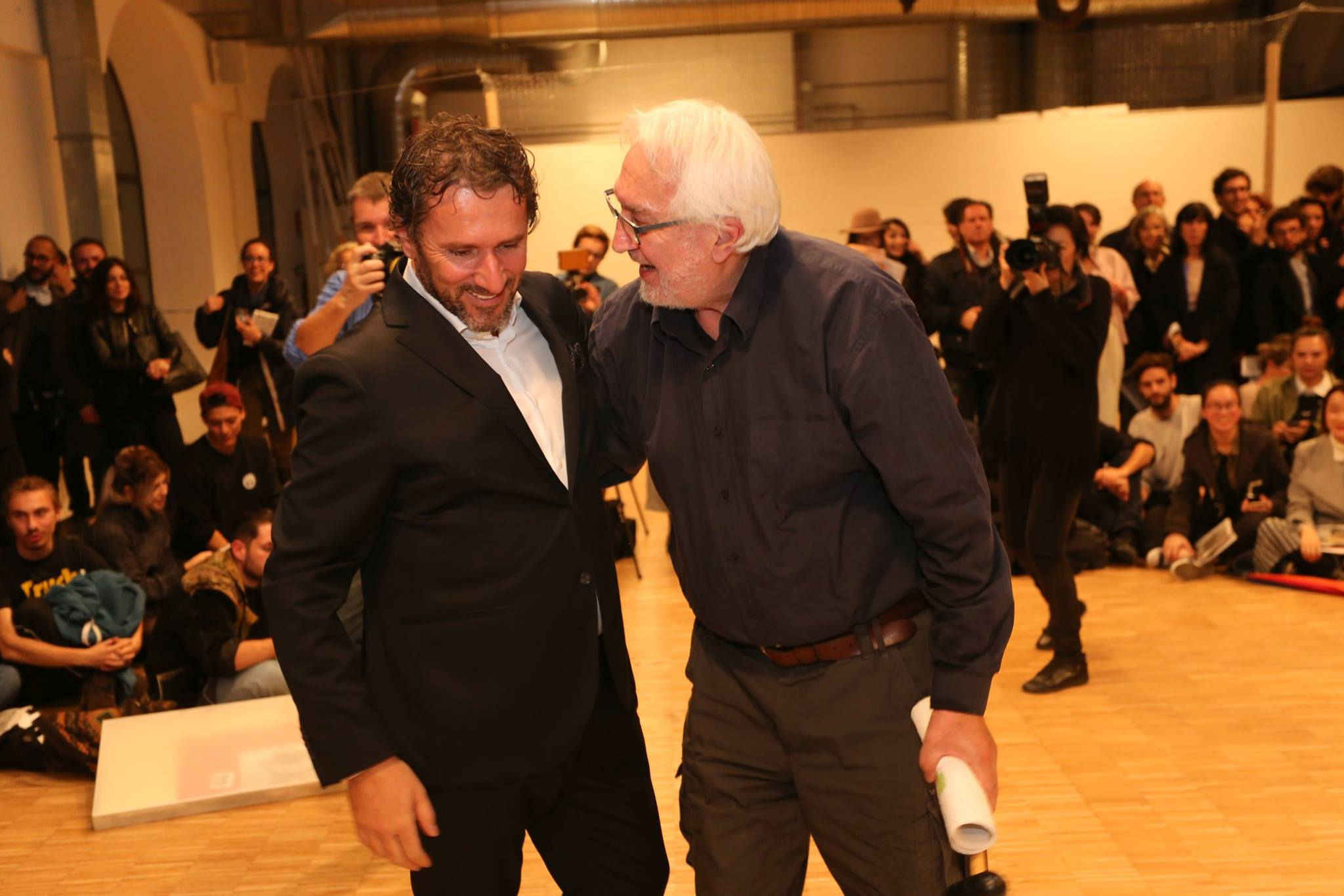 Marinko Sudac and artist Radomir Damnjanović Damnjan following his performance during the 'Non-Aligned Modernity. Eastern-European Art and Archives from the Marinko Sudac Collection' exhibition in Milan, 2016. Courtesy of Marinko Sudac.