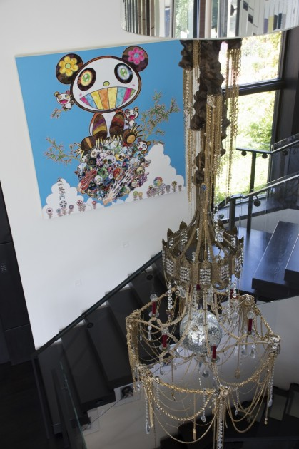 The art-decorated staircase with Takashi Murakami and DZINE (Carlos Rolon). Photo: Emily Hoerdemann. Courtesy of Amy Phelan.