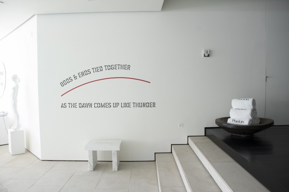 Works by Jim Torok, Lawrence Weiner, Jenny Holzer and Don Brown next to the indoor swimming pool. Photo: Emily Hoerdemann. Courtesy of Amy Phelan.