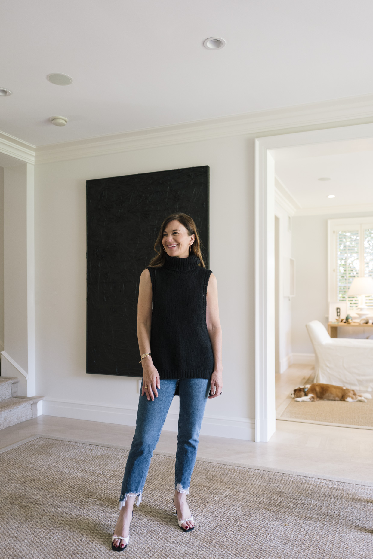 Sarah Harrelson in front of a piece by Rashid Johnson. Courtesy of Sarah Harrelson.
