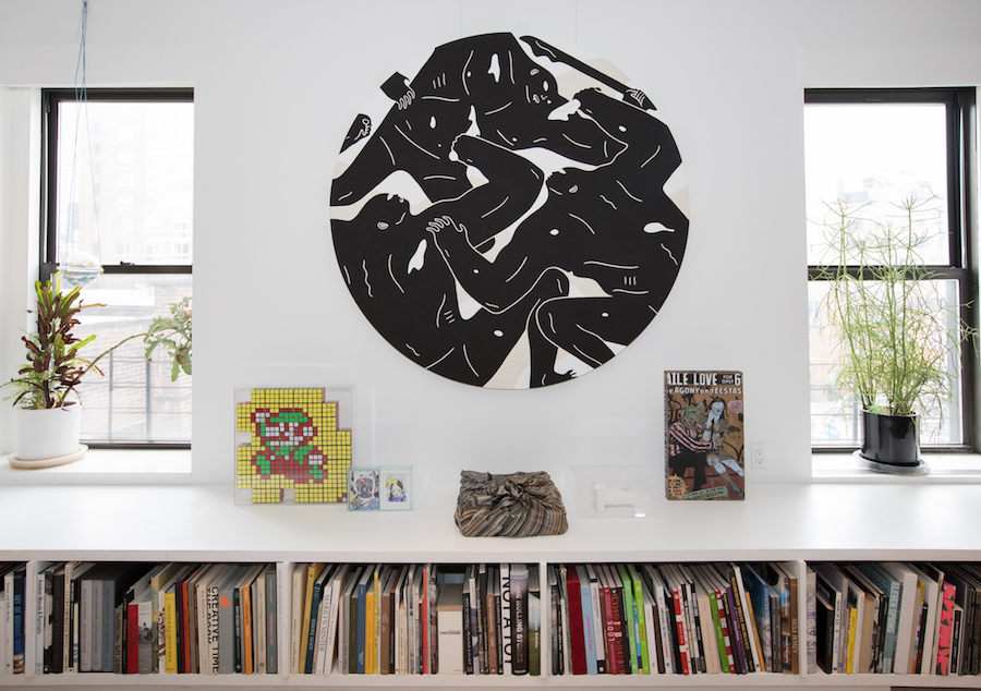 The living room with artworks by Cleon Peterson, Invader, Faile, Clayton Brothers, Daniel Arsham. Courtesy of Sara and Marc Schiller.