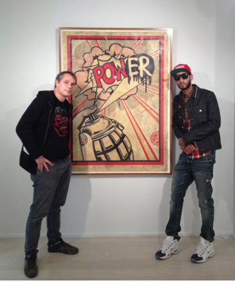 Swizz Beatz (right) at Shepard Fairey's (left) gallery opening at Pace Prints, 2012. Photo: Rap-Up.com