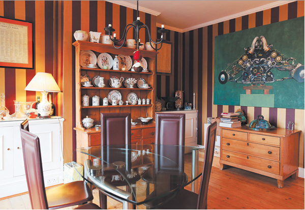 Michel Roux's dining room with a painting by French artist Pierre Yves Gervais. Photo: Charlie Bibby, The FT.