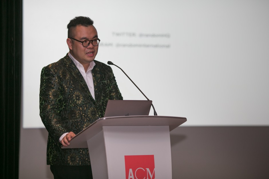 Ryan Su delivering the Opening Address at a talk hosted by The Ryan Foundation — The Dark Side of the Swarm lecture by Hannes Koch, co-founder of Random International (2017). Asian Civilisations Museum, Singapore. Courtesy of The Ryan Foundation.