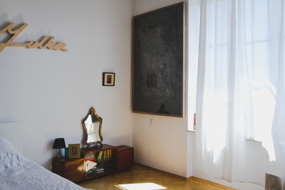 Bedroom interior with artworks: (from the left) Michal Gayer, Krwawa Julka (broken neon), 2009 and Witek Orski, Earthhole #2, 2015. Courtesy of Borowik Collection.