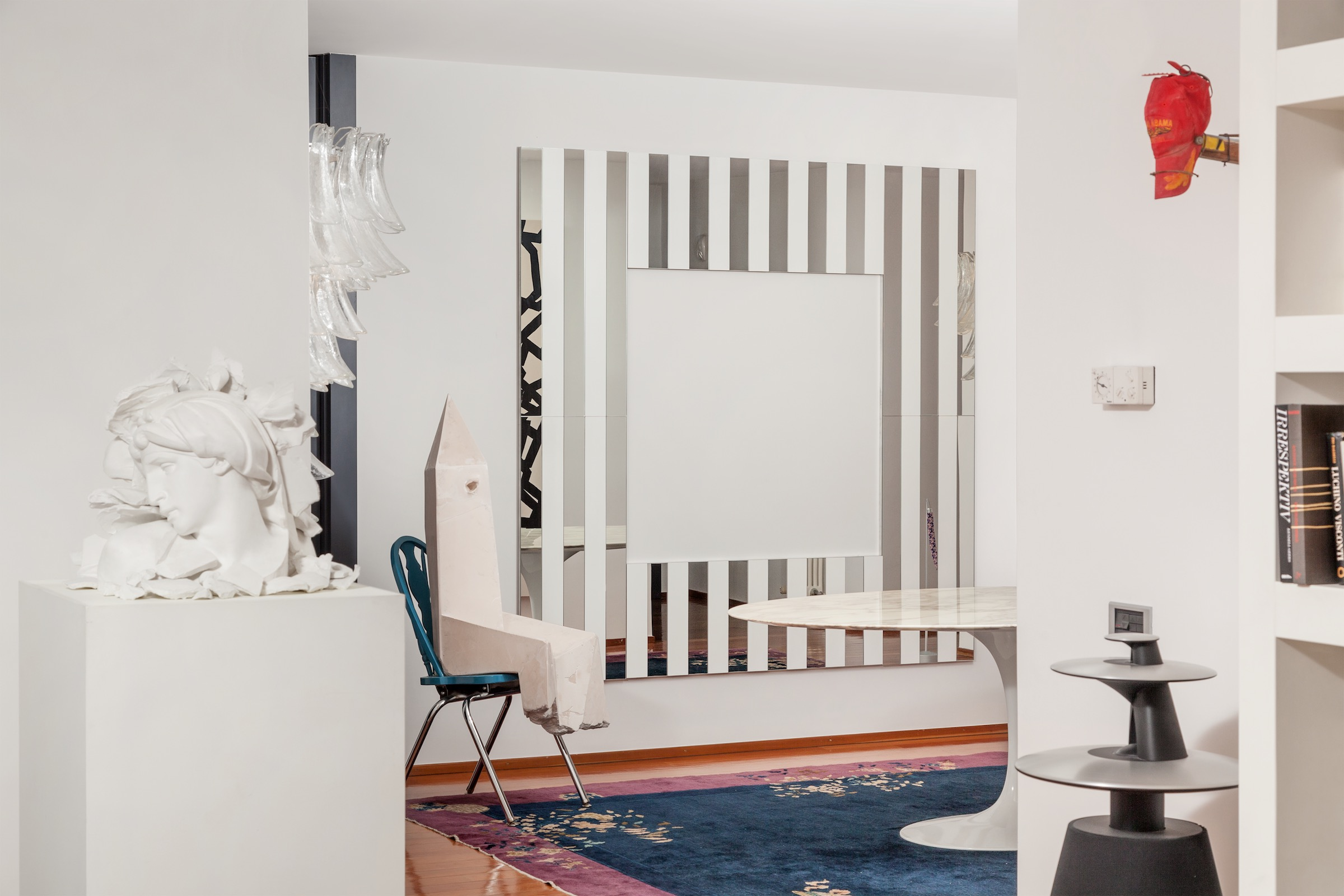 An interior filled with art by Giulio Paolini, Mike Nelson, Daniel Buren, and Andra Ursuta. Photo: Pietro Cocco. Courtesy of Mauro De Iorio.