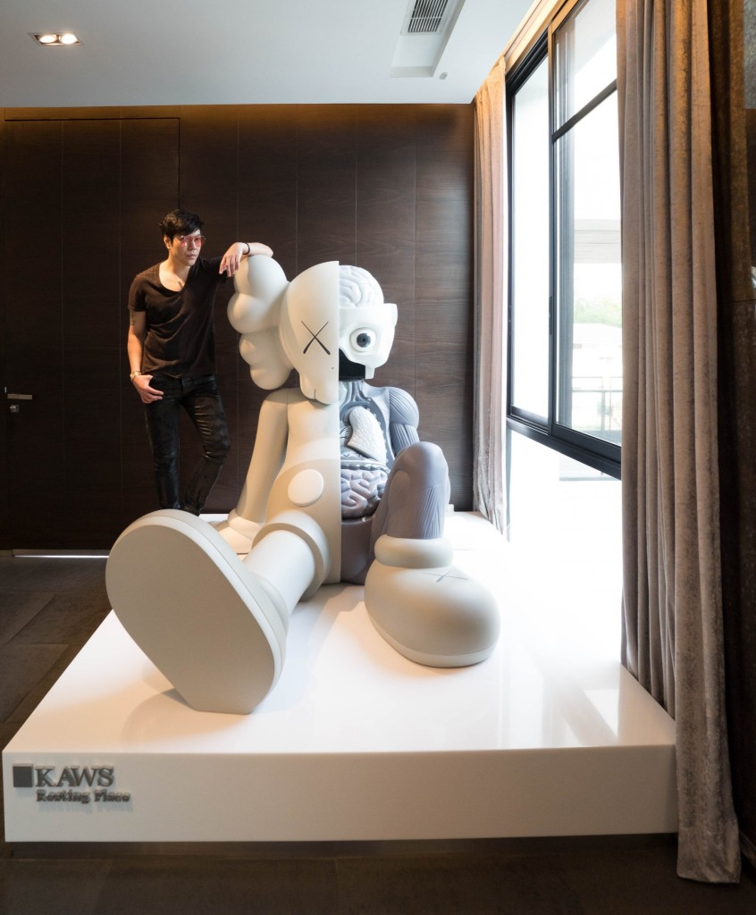 Kong with KAWS sculpture. Courtesy of Kong Karoon Sosothikul.