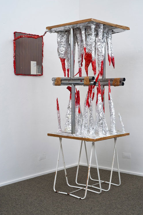 Thomas Hirschhorn, Untitled (Stalactites-red-table), 1997. Courtesy of Sammlung Peters-Messer.