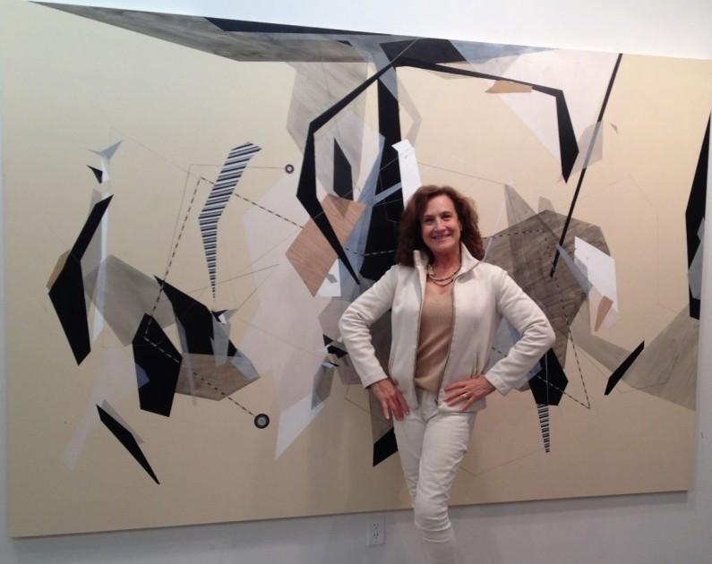 Jane Wesman with Danielle Tegeder painting in artist's studio