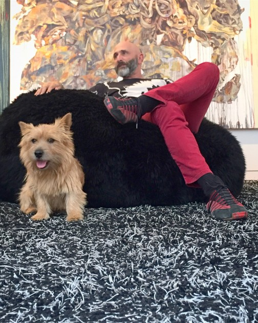 Jeffrey N. Dauber and his dog Woddy, with a piece by Hung Liu at the back. Courtesy of Jeffrey N. Dauber.