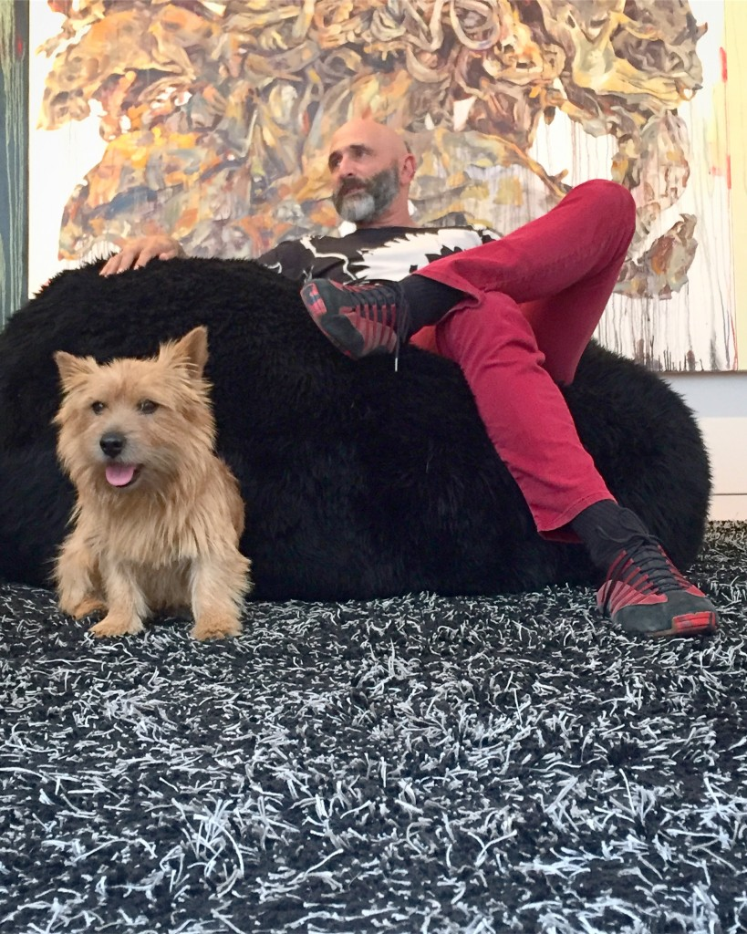 Jeffrey N. Dauber and his dog Woddy, with a piece by Hung Liu at the back. Photo: Tito Vandermeyden. Courtesy of Jeffrey N. Dauber.